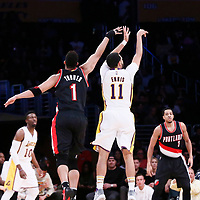 26 March 2016: Los Angeles Lakers guard Tyler Ennis (11) takes a jump shot past Portland Trail Blazers guard Evan Turner (1) during the Portland Trail Blazers 97-81 victory over the Los Angeles Lakers, at the Staples Center, Los Angeles, California, USA.