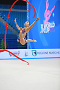 Assymova Aliya during qualifying at ribbon in Pesaro World Cup 11 April 2015.<br />