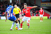 Milan Lalkovič of Walsall FC goes past Donervon Daniels of Wigan Athletic during the Sky Bet League 1 match between Walsall and Wigan Athletic at the Banks's Stadium, Walsall, England on 20 February 2016. Photo by Mike Sheridan.