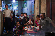 Kashgar: Han  Chinese mix with Uighur families in small street food restaurants near Id Khar mosque in Kashgar...Despite the migration of millions of Han Chinese to the western part of the Xinjiang Uighur Autonomous Region, the Uighur community continue to practice their muslim culture and resist the suppression of their cultural and religious traditions by the Chinese government....The chinese government has been criticised for the redevelopment of the old city, which has involved the destruction of many of the old houses in the town that were built without regulation, officials claiming them to be overcrowded and uncompliant with earthquake codes...Many in the chinese government believe Kashgar to a breeding ground for Uighur separatists, who Beijing claim to have links to terrorism...The european parliament has called for a halt to the cultural destruction of Kashgar, suggesting that Kashgar be added tot he UNESCO World heritage 'Silk Road' project, and calling on the chinese government to develop a genuine Han-Uighur dialogue to adopt more inclusive and comprehensive economic policies in Xinjiang in order to protect the cultural identity of the Uighur population..©JTanner/July 2011