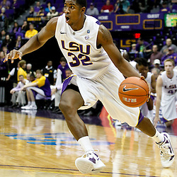 December 29, 2011; Baton Rouge, LA; LSU Tigers guard John Isaac (32) drives with the ball against the Grambling State Tigers during the first half of a game at the Pete Maravich Assembly Center.  Mandatory Credit: Derick E. Hingle-US PRESSWIRE