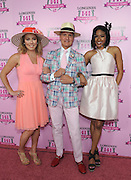 """Longines Ambassador of Elegance and World Cup Alpine skier Mikaela Shiffrin, left, poses with Monte Durham, center, of """"Say Yes to the Dress,"""" and Alicia Quarles, of E! News, at the Longines Kentucky Oaks Fashion Contest on Kentucky Oaks Day, Friday, May 1, 2015, in Louisville, Ky. Longines, the Swiss watch manufacturer known for its luxury timepieces, is the Official Watch and Timekeeper of the 141st annual Kentucky Derby. (Photo by Diane Bondareff/Invision for Longines/AP Images)"""