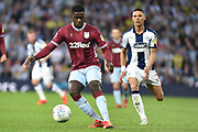 Aston Villa defender (on loan from Manchester United) Axel Tuanzebe (4) shields the ball from West Bromwich Albion defender Kieran Gibbs (3)during the EFL Sky Bet Championship play-off second leg match between West Bromwich Albion and Aston Villa at The Hawthorns, West Bromwich, England on 14 May 2019.