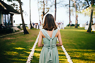 A bridesmaid walks down the aisle during a wedding ceremony, Ko Samui, Thailand, Southeast Asia