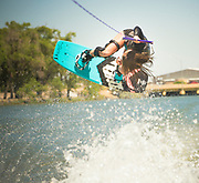 Female athlete wake boarding on the Snake River in Burley, Idaho.