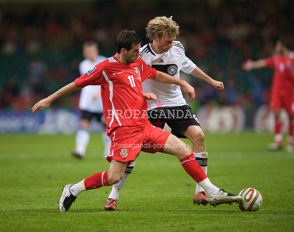 CARDIFF, WALES - Wednesday, April 1, 2009: Wales' Joe Ledley and Germany's Simon Rolfes during the 2010 FIFA World Cup Qualifying Group 4 match at the Millennium Stadium. (Pic by David Rawcliffe/Propaganda)