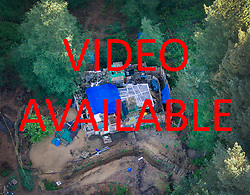 VIDEO AVAILABLE ON : https://tinyurl.com/yarslewr<br /> <br />   &copy; Licensed to London News Pictures. 20/05/2017. Coldharbour, UK. The 'Protection Camp' on Leith Hill.  Protestors have constructed and occupied a fort and some trees on the site of a proposed oil well drilling rig. Planning permission for 18 weeks of exploratory drilling was granted to Europa Oil and Gas in August 2015 after a four-year planning battle. The camp was set up by protestors in October 2016 in order to draw  attention to plans to drill in this Area of Outstanding Natural Beauty (AONB) in the Surrey Hills. The camp has received support from the local community.  Photo credit: Peter Macdiarmid/LNP