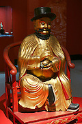 "Linz, Austria. Schlossmuseum (Castle Museum).<br /> Marco Polo exposition ""Von Venedig nach China (From Venice to China)"".<br /> Copy of the idol with effigy of Marco Polo, worshipped in the Temple of 500 Genii in Canton. Gilded wood, 19th century."