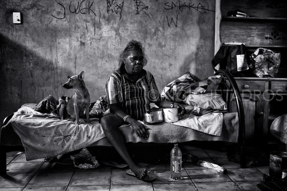 Esther Yumbi having breakfast in her home in Kennedy Hill. Due to excessive alcohol consumption she has been diagnosed with kidney disease and now is being treated in Perth Hospital 2300 km away. Broome, Western Australia. ©Ingetje Tadros/Diimex