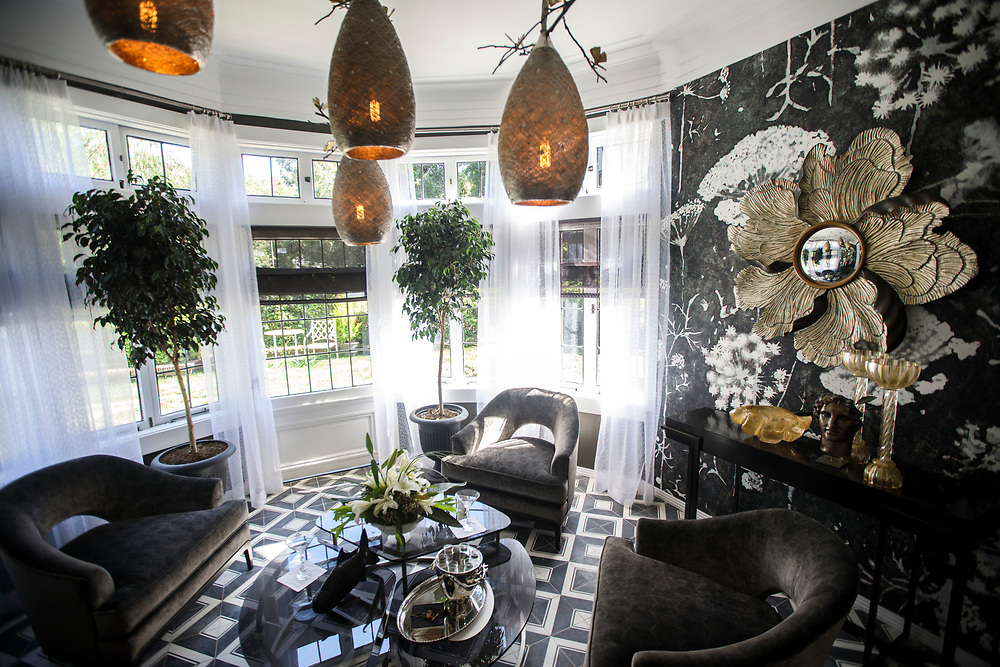 The Conservatory room featuring large silver and bronze petal mirrors - by David Reaume Construction & Design - after renovations inside the Pasadena Showcase House of Design on Wednesday, April 12, 2017 in Pasadena, Calif. The 1916 English estate home was updated for modern living by interior and landscape designers. © 2017 Patrick T. Fallon