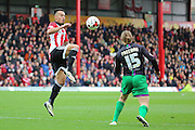 Brentford defender, Nico Yennaris (28) challanging for ball with Bristol City striker, Luke Freeman (15) during the Sky Bet Championship match between Brentford and Bristol City at Griffin Park, London, England on 16 April 2016. Photo by Matthew Redman.