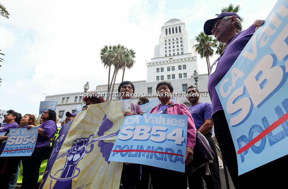 A group from various advocate organizations  protest outside Los Angeles City Hall on September 14, 2017, to call on the state Assembly to pass SB 54, the so-called sanctuary state legislation. The bill would protect communities from President Donald Trump's ``mass deportation agenda'' and prevent state resources being<br /> used to separate families.(Photo by Ringo Chiu)<br /> <br /> Usage Notes: This content is intended for editorial use only. For other uses, additional clearances may be required.