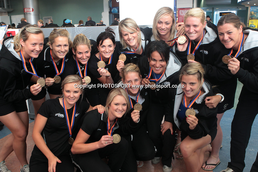 The team pose for a group photo with their medals. Black Sticks Women's arrive at Auckland Airport after winning Bronze in the Champions Trophy. Auckland, New Zealand. Wednesday 6 July 2011. Photo: Ella Brockelsby/photosport.co.nz