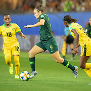 GRENOBLE, FRANCE June 18.  Caitlin Foord #9 of Australia defends by Sashana Campbell #12 of Jamaica and Trudi Carter #18 of Jamaica during the Jamaica V Australia, Group C match at the FIFA Women's World Cup at Stade des Alpes on June 18th 2019 in Grenoble, France. (Photo by Tim Clayton/Corbis via Getty Images)