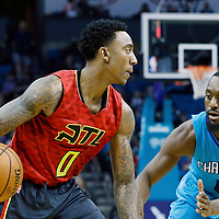01 November 2015: Atlanta Hawks guard Jeff Teague (0) drives past Charlotte Hornets guard Kemba Walker (15) during the Atlanta Hawks 94-92 victory over the Charlotte Hornets, at the Time Warner Cable Arena, in Charlotte, North Carolina, USA.