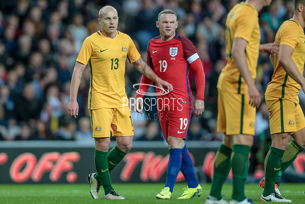 Wayne Rooney (England) is marked by Aaron Mooy (Australia) during the Friendly International match match between England and Australia at the Stadium Of Light, Sunderland, England on 27 May 2016. Photo by Mark P Doherty.