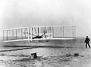 The first powered flight, December 17 1903, Kitty Hawk, North Carolina.  Wilbur and Orville Wright. Photograph Acknowledgement must be made to The Smithsonian Institution