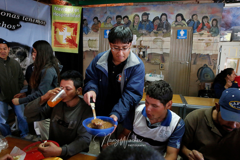 "Kino Teen Gerardo Perez serves beans to deported migrants inside the ""comedor,"" the kitchen and dinning hall of the Aid Center for Deported Migrants, in Nogales, Sonora, in this 2014 file photo. Pope Francis wrote a personal letter to the Kino Border Initiative's executive director praising and encouraging the teens in their work for migrants. ( (Photo taken April 2, 2014) (Photo by Nancy Wiechec)"