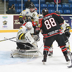 "TRENTON, ON  - MAY 5,  2017: Canadian Junior Hockey League, Central Canadian Jr. ""A"" Championship. The Dudley Hewitt Cup. Game 7 between Georgetown Raiders and the Powassan Voodoos.  Nate McDonald #33 of the Powassan Voodoos makes the save as Andrew Court #88 of the Georgetown Raiders drives to the net during the third period.<br /> (Photo by Tim Bates / OJHL Images)"