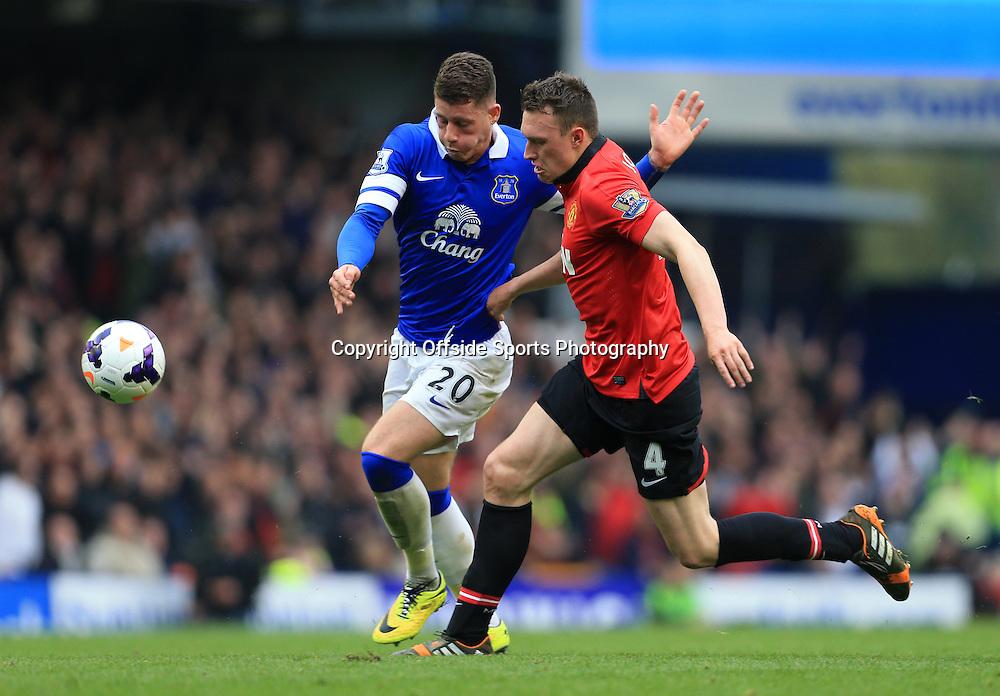 20th April 2014 - Barclays Premier League - Everton v Manchester United - Phil Jones of Man Utd battles with Ross Barkley of Everton - Photo: Simon Stacpoole / Offside.