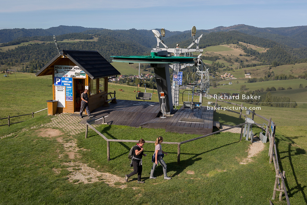 From the viewpoint of the hillside chairlift, a grass meadow landscape looking down on the Polish village of Jaworki, on 21st September 2019, in Jaworki, near Szczawnica, Malopolska, Poland.