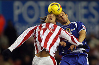 Photo: Paul Thomas.<br /> Stoke City v Cardiff City. Coca Cola Championship. 28/11/2006.<br /> <br /> Stoke's Darel Russell (L) and Riccardo Scimeca go for the ball.