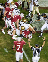 November 28, 2009; Stanford, CA, USA;  Stanford Cardinal fullback Owen Marecic (48) scores a touchdown against the Notre Dame Fighting Irish during the second quarter at Stanford Stadium.  Stanford defeated Notre Dame 45-38.