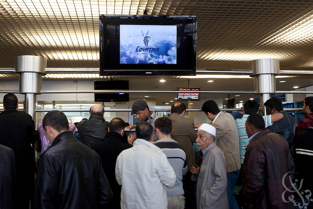 Thousands of travelers wait at the Cairo International airport for available flights out of the country January 30, 2011 in Cairo, Egypt. Many of the travelers included Egyptians desperate to flee the country following nearly a week of ongoing unrest that threatens to bring down President Hosni Mubarak's regime.