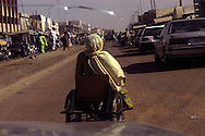 Zainab Adamu, 50, pedals through busy streets on her hand-powered tricycle after attending the women's meeting at the Kano Polio Victims' Association. The trip is 20 kilometers (about 12.5 miles) from her neighborhood of Shadara Bata to the polio victims' center. The Nigerian woman lives a full life, despite the burden of polio.