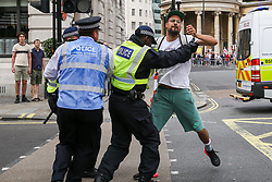 "© Licensed to London News Pictures. 03/08/2019. London, UK. Police detain a protester during ""Free Tommy Robinson"" protest in central London. Last month Tommy Robinson was given a nine-month prison sentence at Old Bailey after he was found guilty of contempt of court.. Photo credit: Dinendra Haria/LNP"