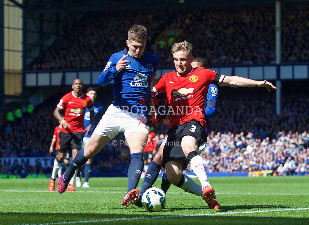 LIVERPOOL, ENGLAND - Sunday, April 26, 2015: Everton's John Stones in action against Manchester United's Luke Shaw during the Premier League match at Goodison Park. (Pic by David Rawcliffe/Propaganda)