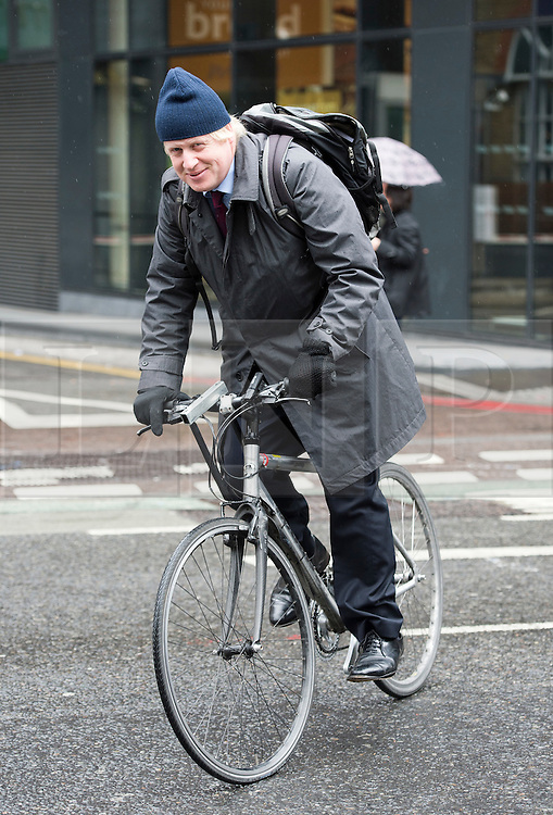 © London News Pictures. 05/05/2012. London, UK. BORIS JOHNSON leaving London City Hall on his bike after signing the Declaration of Acceptance of Office at London City Hall on May 5, 2012 a day after being elected as Mayor of London for a second term. Photo credit: Ben Cawthra/LNP