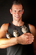 Jeffrey Van Zanten, a volunteer from Holland, holds three orphaned juvenile brown hooded kingfishers (Halcyon Albiventris) at the Chipangali Wildlife Orphanage in Bulawayo, Zimbabwe.