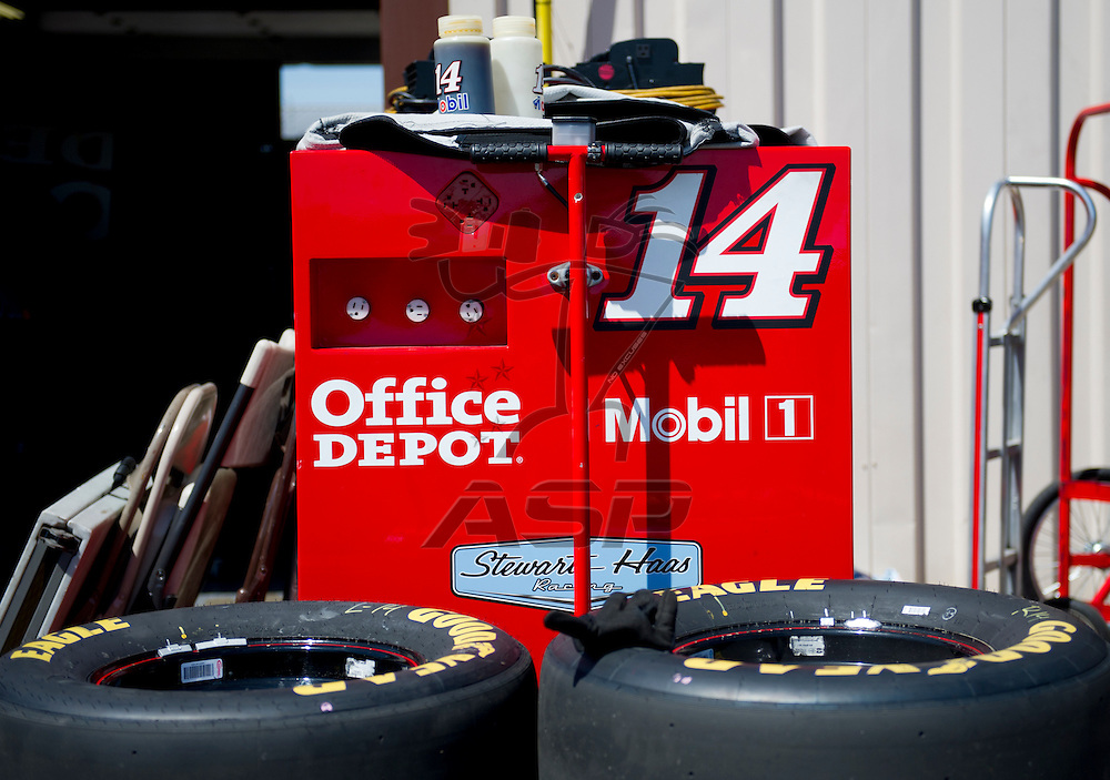 Brooklyn, MI - JUN 14, 2012:  Tony Stewart (14) prepares for the second test session for the Quicken Loans 400 race at the Michigan International Speedway in Brooklyn, MI.