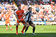 Notts County midfielder Alan Smith (17) battles with Luton Town defender Glen Rea (16) during the EFL Sky Bet League 2 match between Notts County and Luton Town at Meadow Lane, Nottingham, England on 5 May 2018. Picture by Jon Hobley.
