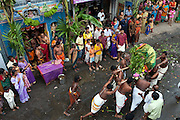The deity, Bhairava, returns to his temple after a parade around the streets. Festival at small Hindu temple off Jampettah Street.