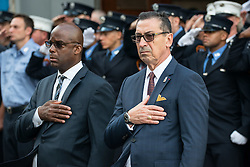 September 11, 2016 - New York, NY, United States - At FDNY Ladder 10/Engine 10 house near the World Trade Center, FDNY Commissioner Daniel Nigro (center right) holds his hand to his heart during a moment of silence to mark the fall of Tower Two. During the formal ceremony at Ground Zero to commemorate the 15th anniversary of the September 11th terrorist attacks on the World Trade Center, the Pentagon and the crash of United Airlines Flight 93 in Shanksville, PA; relatives of the victims commemorated placed flowers on the registry of names constructed around the sites reflecting pools and uniformed FDNY firefighters held a separate commemoration of their fallen colleagues. (Credit Image: © Albin Lohr-Jones/Pacific Press via ZUMA Wire)