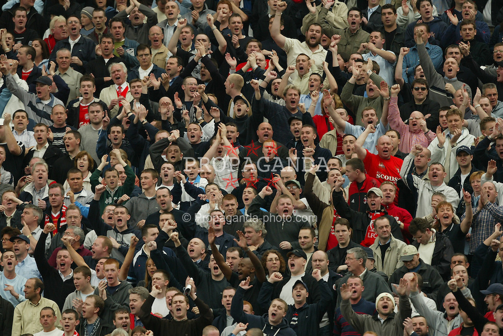 MANCHESTER, ENGLAND - Saturday, April 5, 2003: Liverpool supporters singing against Manchester United during the Premiership match at Old Trafford. (Pic by David Rawcliffe/Propaganda)