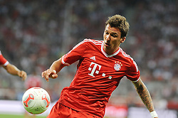 01.08.2013, Allianz Arena, Muenchen, Audi Cup 2013, FC Bayern Muenchen vs Manchester City, im Bild, Mario MANDZUKIC (FC Bayern Muenchen), Einzelbild, angeschnitten, angeschnittenes einzelmotiv, halbfigur, halbe Figur, quer, querformat, horizontal, landscape, Aktion,  // during the Audi Cup 2013 match between FC Bayern Muenchen and Manchester City at the Allianz Arena, Munich, Germany on 2013/08/01. EXPA Pictures © 2013, PhotoCredit: EXPA/ Eibner/ Wolfgang Stuetzle<br /> <br /> ***** ATTENTION - OUT OF GER *****
