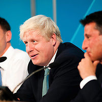 London, UK - 13 August 2012: Jeremy Hunt, Boris Johnson and Sebastian Coe during the final press conference of the Olympic Games to discuss the success of London 2012.
