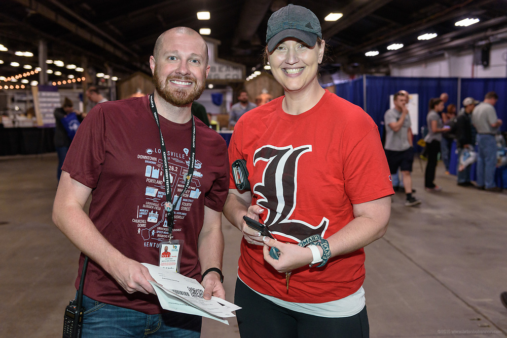 Runners pick up their athlete packets and shop in the vendor mall at Kentucky Derby Festival's Race Expo and Packet Pickup Thursday, April 27, 2017, in the West Wing of the Kentucky Exposition Center in Louisville, Ky. (Photo by Brian Bohannon)