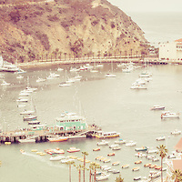 Avalon California Catalina Island panorama photo. Santa Catalina Island Avalon Bay from above with the Avalon Casino, Avalon Pier, Holly Hill House, and the Avalon waterfront along the Pacific Ocean. High resolution picture has vintage nostalgic tone.