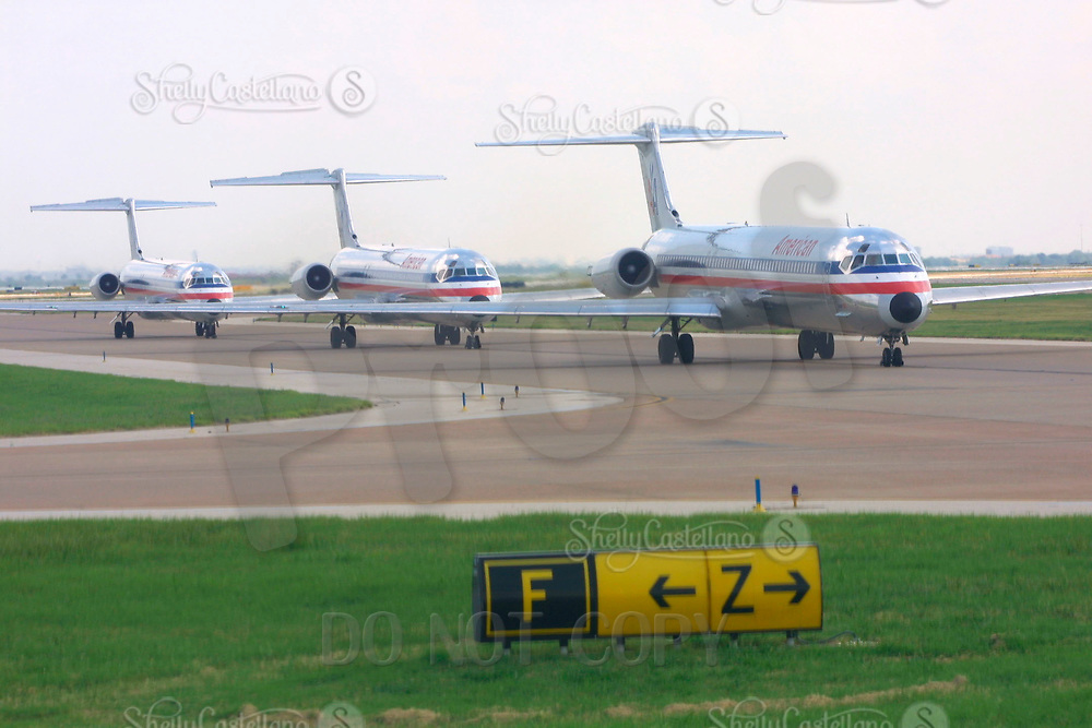Jun 21, 2002; Dallas, TX, USA; American Airlines planes backed up on the Dallas Fort Worth DFW runway on the first day of summer air travel traffic. Airplanes line up for take off into the busy skies over Texas.  Mandatory Credit: Photo by Shelly Castellano/ZUMA Press. (©) Copyright 2002 by Shelly Castellano