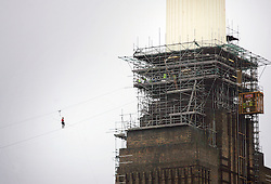 © under license to London News Pictures.  28/2/11 Blue presenter Helen Skelton attempts a hire-wire walk between the chimneys of the disused Battersea Power Station in aid of Red Nose Person. She is the first person to have attempted this. Photo credit should read: Olivia Harris/ London News Pictures
