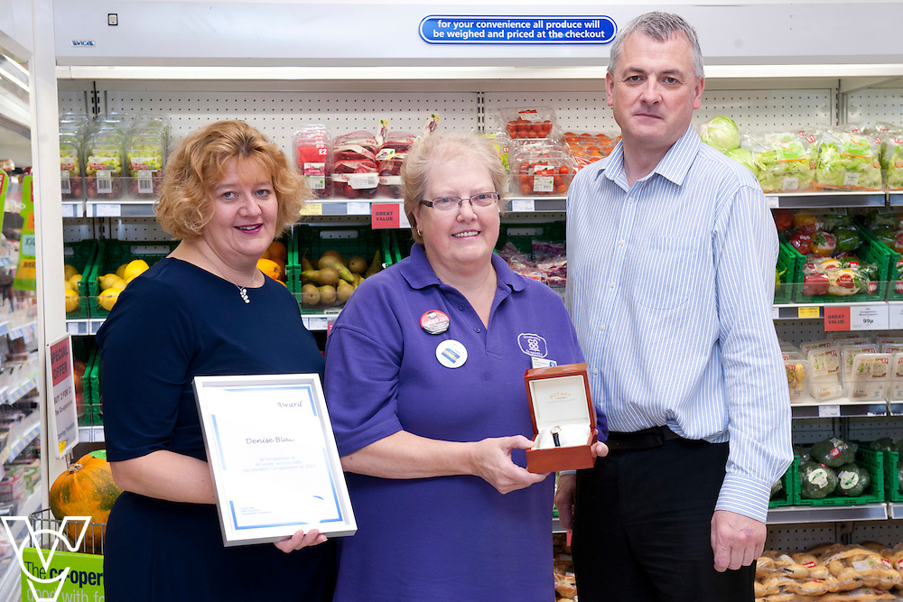 Pictured, from left, Lincolnshire Co-operative head of people and performance Heather Lee, Denise Black and Lincolnshire Co-operative regional manager Chris Cocking<br /> <br /> Denise Black has who works at the Lincolnshire Co-operative Nunsthorpe food store, in Grimsby, has worked for the company for 40 years!<br /> <br /> Picture: Chris Vaughan/Chris Vaughan Photography<br /> Date: October 23, 2015