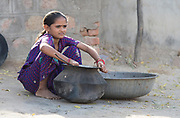 Young girl preparing food in Chanoud, Rajasthan, India.