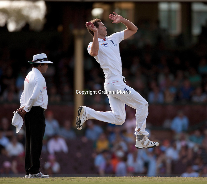 Chris Tremlett runs in to bowl past umpire Aleem Dar during the fifth and final Ashes test match between Australia and England at the SCG in Sydney, Australia. Photo: Graham Morris (Tel: +44(0)20 8969 4192 Email: sales@cricketpix.com) 06/01/11