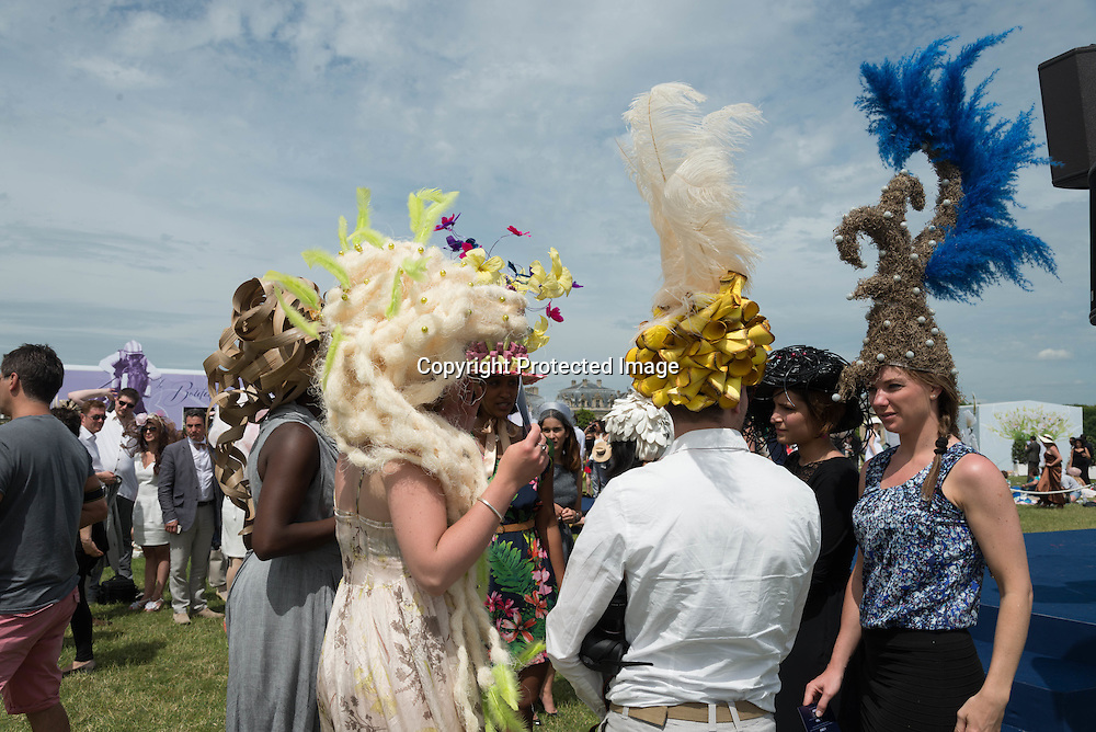 Women show off their colorful hats while attending the Grand Prix de Diane horse race in Chantilly, France, 16 June 2013. This race is one of the most prestigious horse races in France