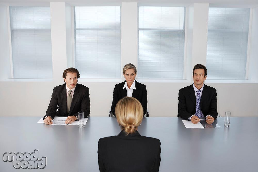 Businesswoman Giving Presentation to Executive Team