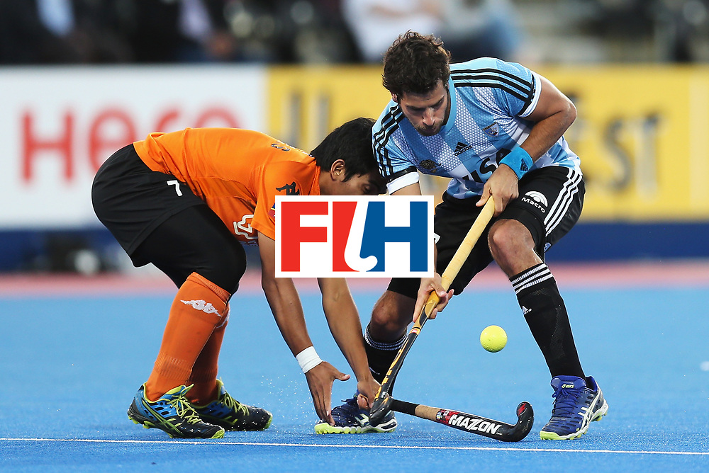 LONDON, ENGLAND - JUNE 16: Fitri Saari of Malaysia tackles Juan Lopez of Argentina during the Pool A match between Argentina and Malaysia on day two of Hero Hockey at Lee Valley Hockey and Tennis Centre on June 16, 2017 in London, England.  (Photo by Alex Morton/Getty Images)